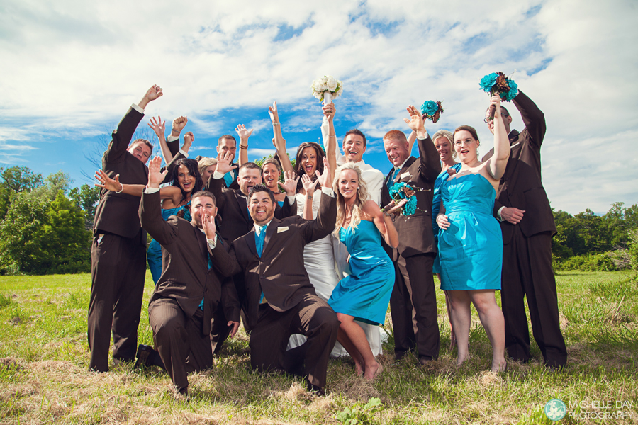 Photo of the wedding party in teal dresses in Buffalo, NY