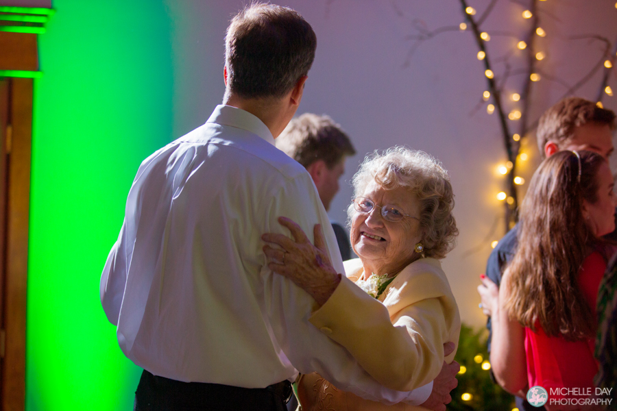 The bride's grandmother dancing at the wedding reception in Eden NY